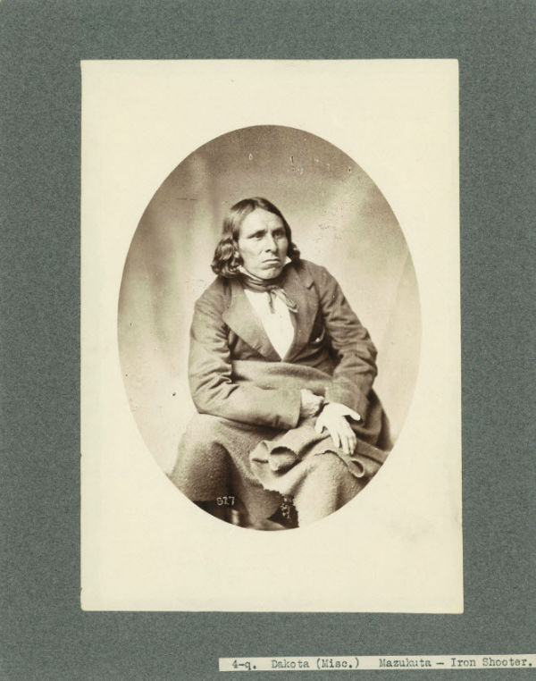 Studio portrait of Dakota Indian Iron Shooter